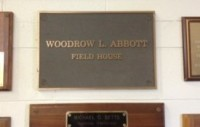 This plaque displays the real name of the field house.