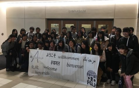 Exchange students pose for a picture before departing.