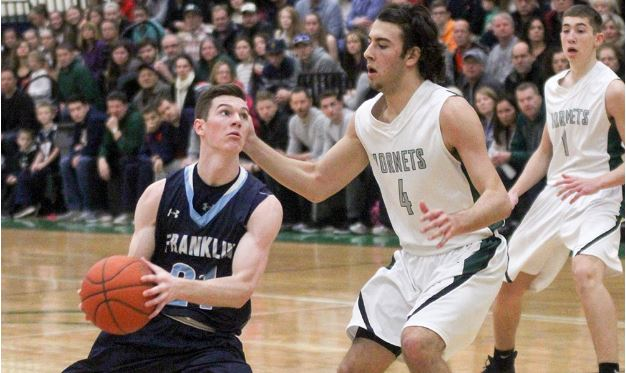 Franklin's Paul Mahon drives past Mansfield's Sam Goldberg in the Panthers' win earlier this year (Ryan Lanigan, HockomockSports.com)