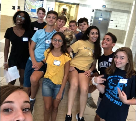 Students+take+a+selfie+as+part+of+their+scavenger+hunt