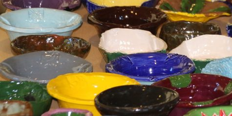 An array of colorful bowls on display at the spring auction! Photo Credit: Corey Seeman.