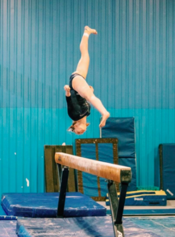 FHS junior gymnast, Kate Rudolph, demonstrating her skills on beam!