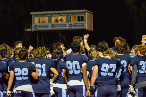 Franklin Panthers gather after their 35-0 blowout against Taunton