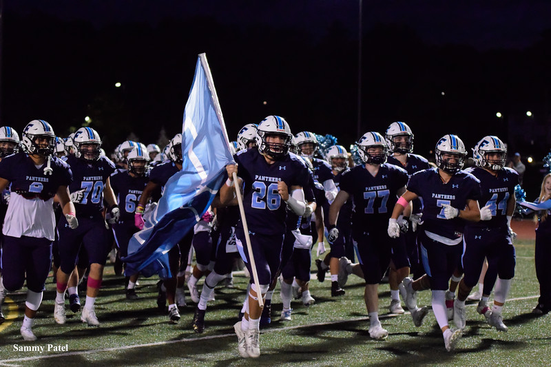 Franklin Panthers run onto the field to face the Mansfield Hornets